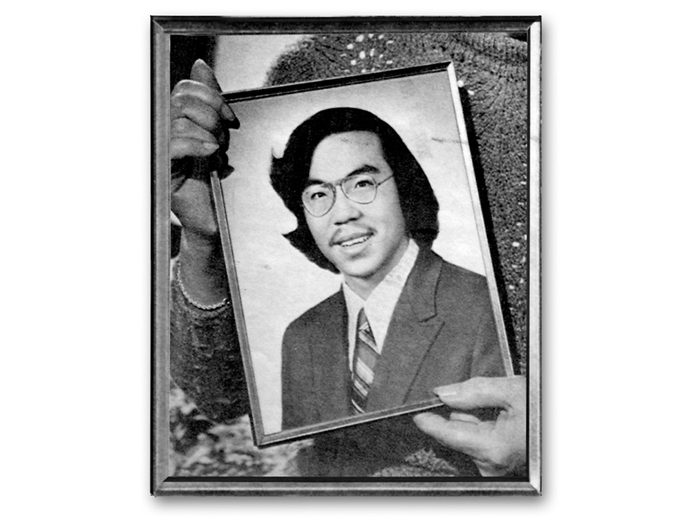 Hands holding a photograph of Vincent Chin