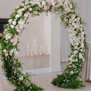 Moongate arch with greenery and florals   Size 2.1m tall & 2.5m wide