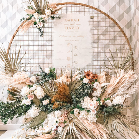 Personalised order of the day with mesh backdrops and dried florals