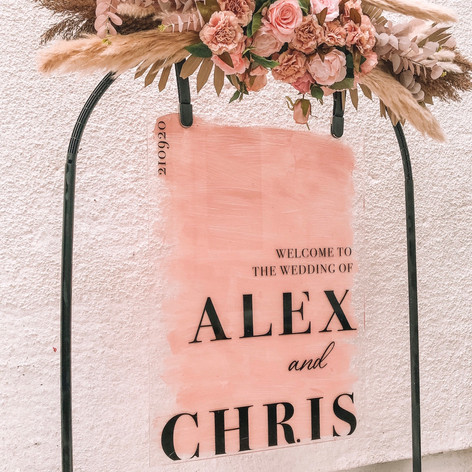 Personalised pink welcome sign with black frame and florals