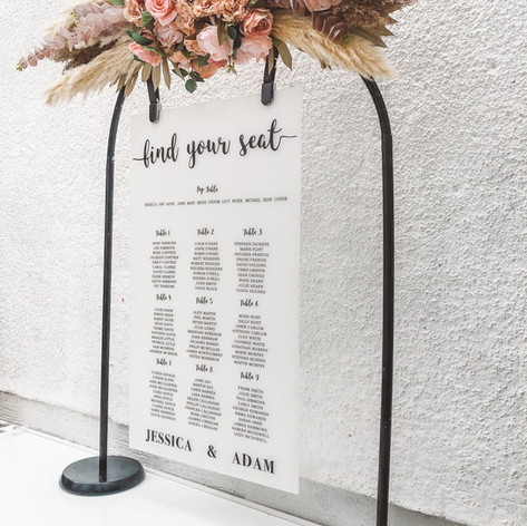 Personalised table plan with balck frame and florals
