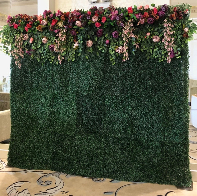 Green flower wall with colourful floral garland   Size - 2.5m wide & 2.2m tall