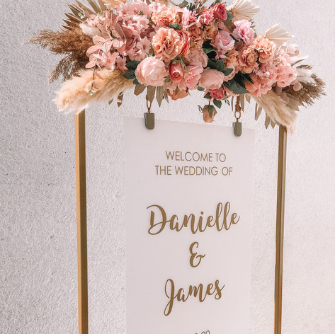 Personalised welcome sign with gold frame and florals