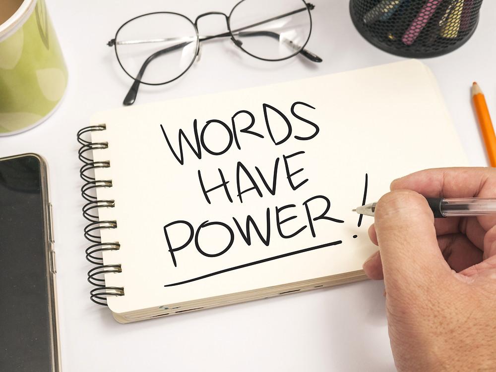Words have power handwritten on spiral bound notebook