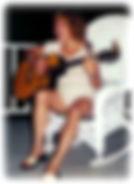 Guitar on porch edge.jpg