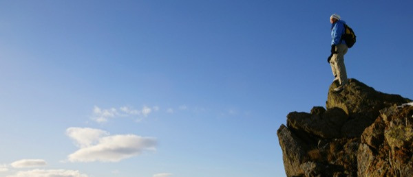 A climber atop a mountain