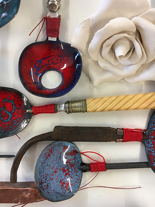 red spoon with porcelain