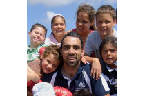 Proud and Strong Aboriginal Man, Adam Goodes with Kids playing traditional Indigenous games