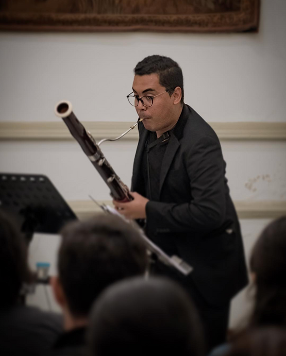 cristian coliver bassoon playing standin