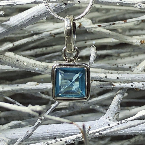 Blue topaz December birth stone . Sterling silver square pendant.
