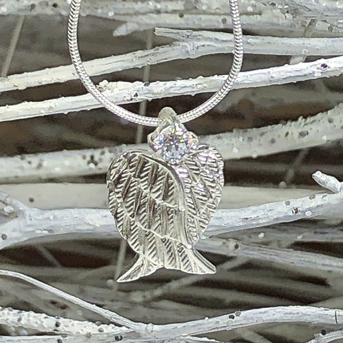 Sparkling silver heart wing pendant