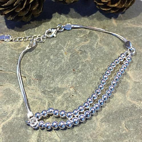 SIlver Ball bracelet adjustable. Ideal gift