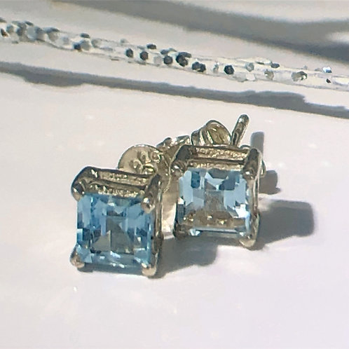 Blue topaz square sterling silver studs. December birth stone