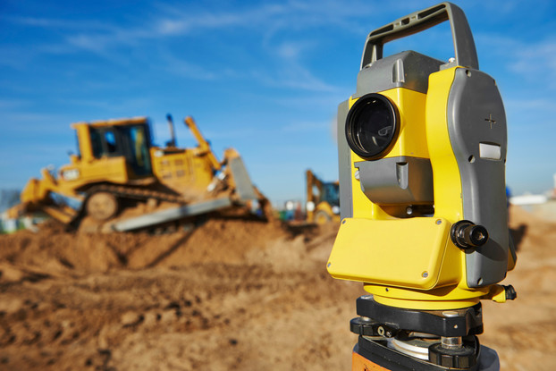 Surveyor-equipment-at-construction-site.