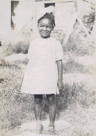 Dr. Marilyn in front of her childhood home in The Bahamas, 1967