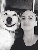 Staff photo of Lorie and her dog, both smiling..