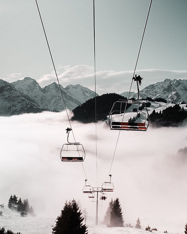 cable-car-near-snow-covered-mountain-378