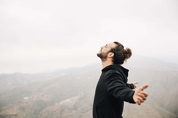 side-view-carefree-man-enjoying-freedom-with-arms-outstretched-min.jpg