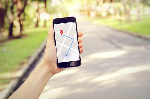 Tourist using navigation app on the mobi