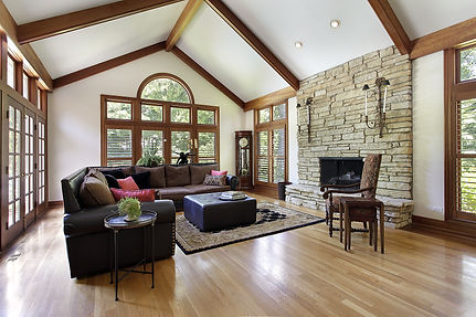 Family room in luxury home with stone fireplace.jpg