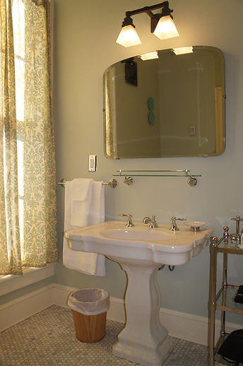 The antique pedestal sink in the Artist's Bath at The Baker House Bed & Breakfast