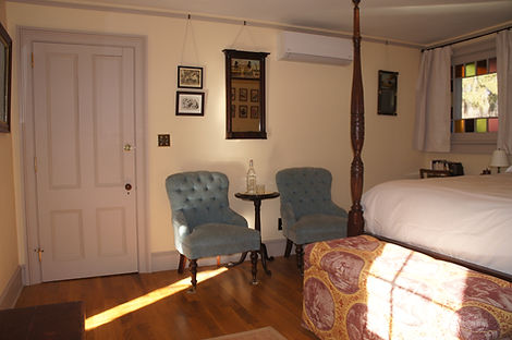 Pair of upholstered chairs in the Artist's Room at The Baker House Bed & Breakfast