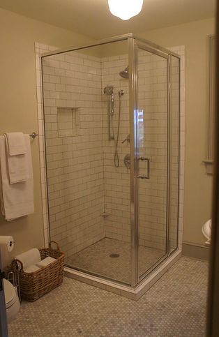 The shower and heated marble floor in The Gardener's bath at The Baker House Bed & Breakfast
