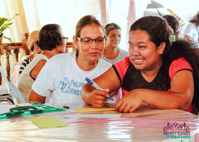 "Judy Gacita (right), Secretary of Special and Differently Abled Persons of Lawaan, joyfully participates in one of the workshops during the 1st DPO Leadership Training and Organizational Management held last September 15-16, 2016. She said that through the activities of Project ELEVATE, she gained self-confidence. ""If my fellow persons with disability can do it, I can do it too"", Judy proudly stated."