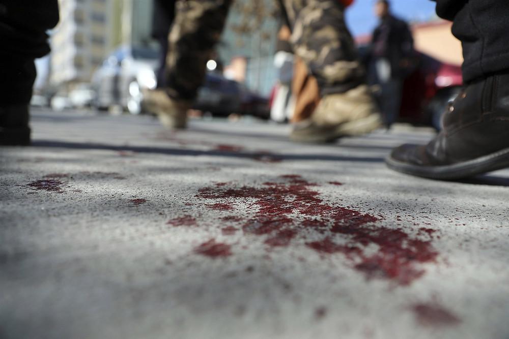 Blood splattered on asphalt after attacks in Afghanistan