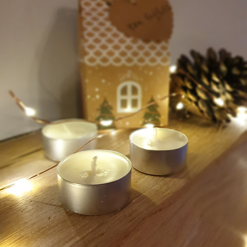 3 Scented tea lights packaged in the gingerbread house.