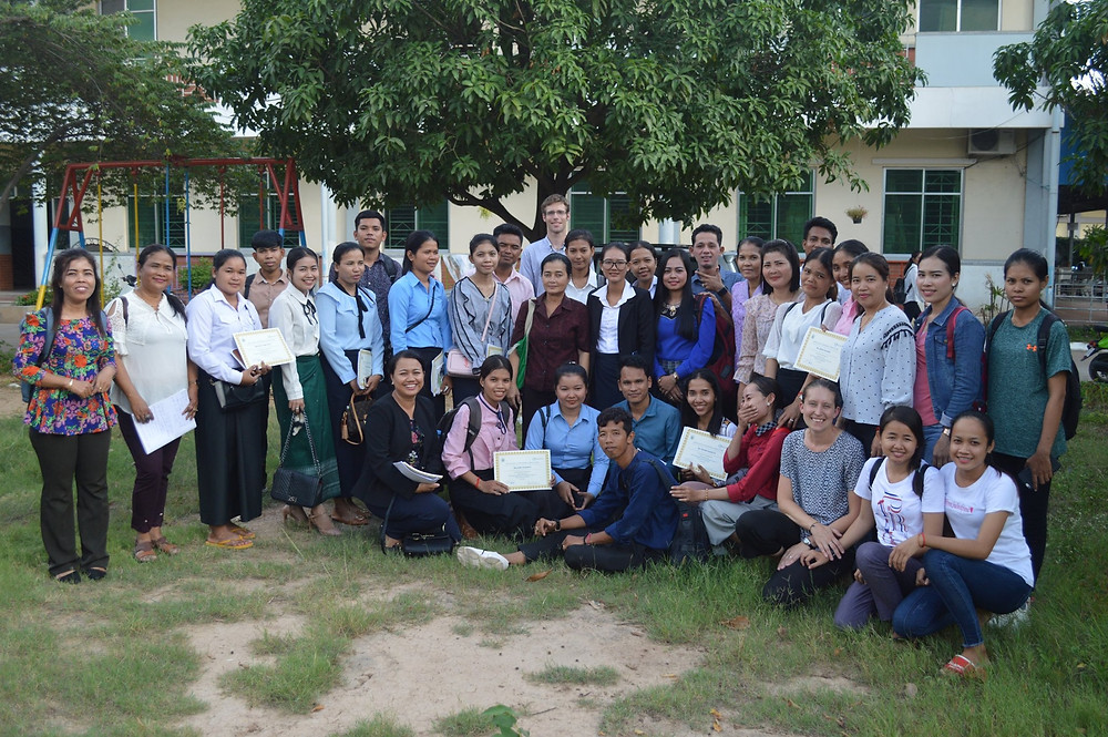 Group of Cambodian trainees outside