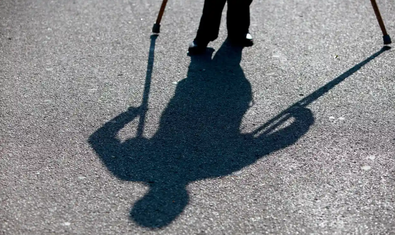 shadow of person with crutches
