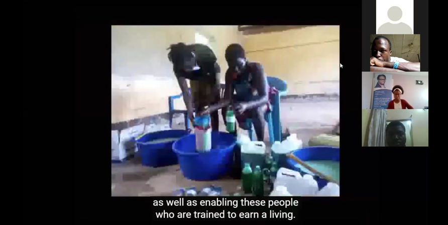 Image of people making liquid soap surrounded by bottles and jugs