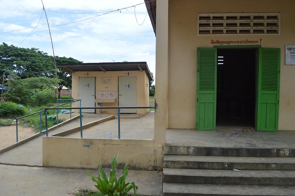 Image of a Cambodian school classroom door with khmer words written above.