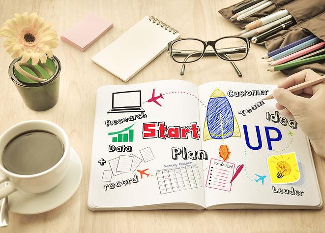Businessman write  Notebook word _Start