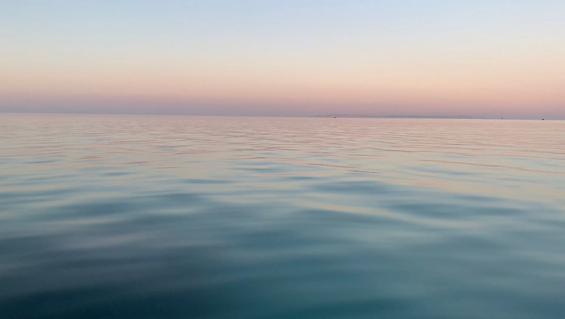 Sunset colors and small ripples over the sea in El Gouna observed from a boat