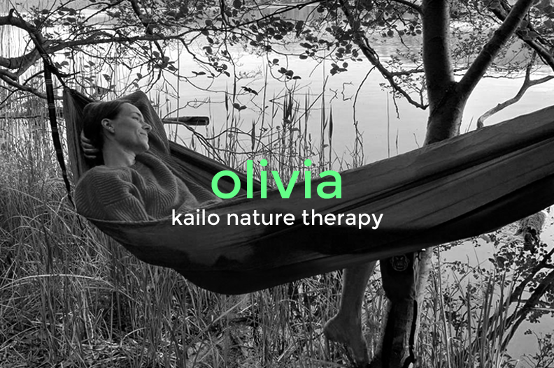 Olivia Köhler, nature therapist at Kailo, in a hammock by Müggelsee in Berlin