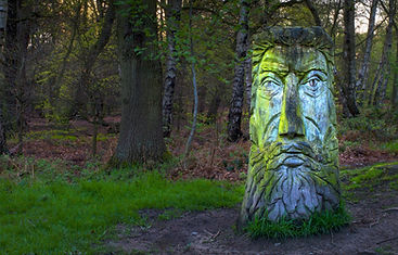 a-green-man-carved-from-a-tree-trunk-522