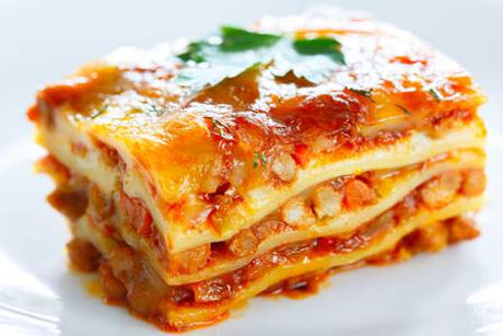 87788397-a-piece-of-lasagna-on-a-white-p