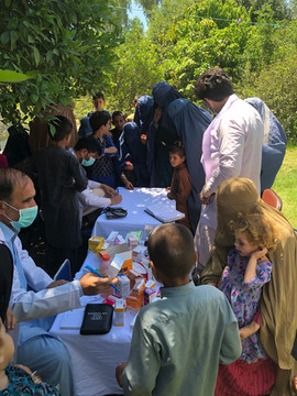 Mobile clinic staff providing essential medicines in rural part of Nangarhar province in Afghanistan