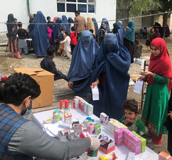 Mobile clinic staff providing essential medicines and treatment in rural part of Nangarhar province in Afghanistan