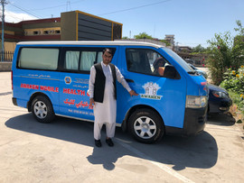 Our AWAKEN Afghanistan Director Abdullah Noori standing with the newly developed mobile clinic