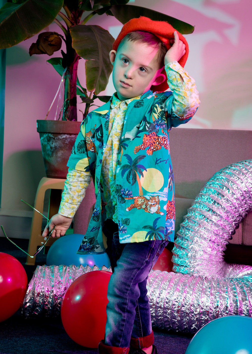 kids fashion photoshoot, child model who has Down syndrome