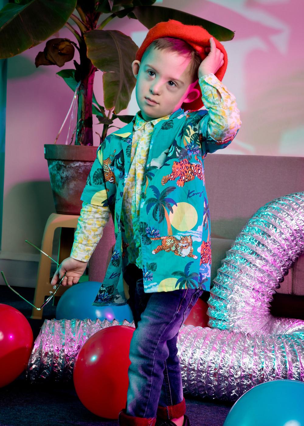 kids fashion photoshoot, child model who has Down syndrome