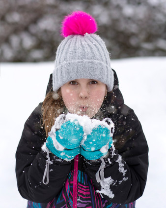 Girl playing in snow portrait