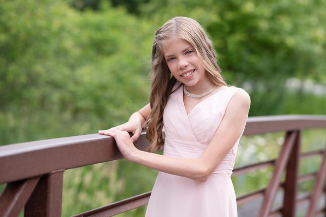 Young girl posing on bridge