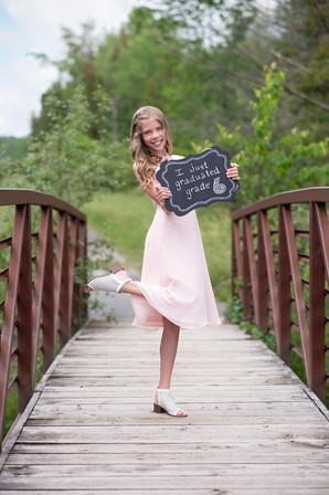 Young girl graduationg grade 6