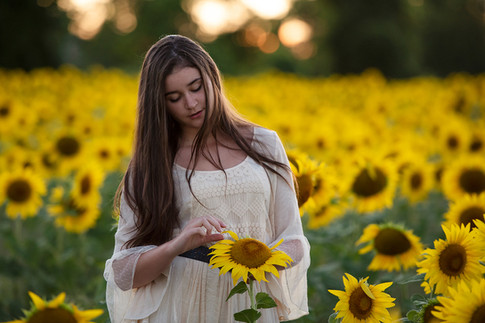 Young teen woman posing in sunflower field