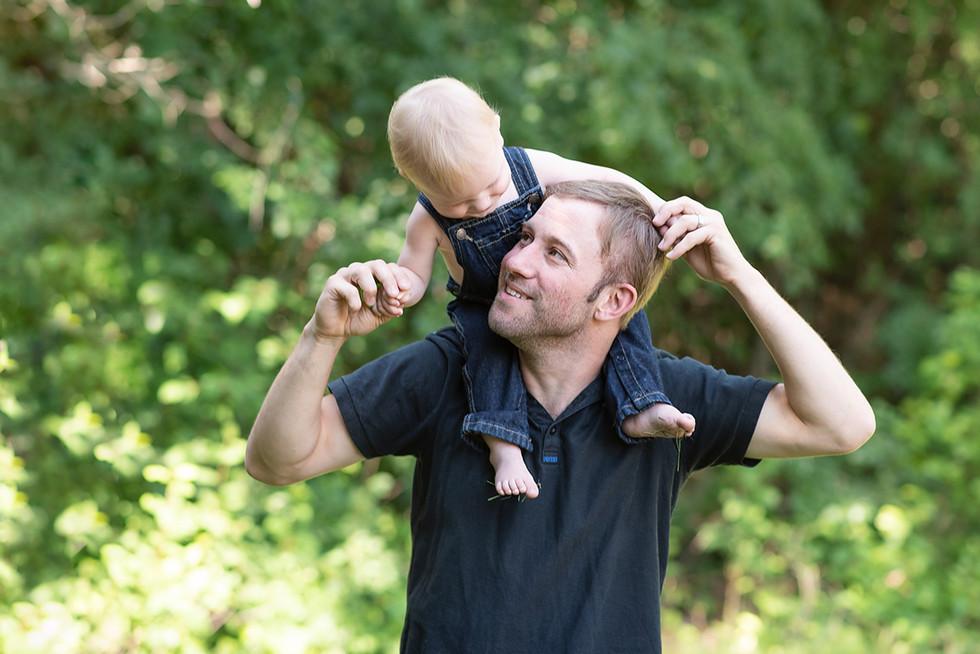 Toddler on Dad's shoulders