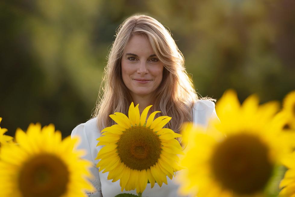 Woman in sunflowers portrait